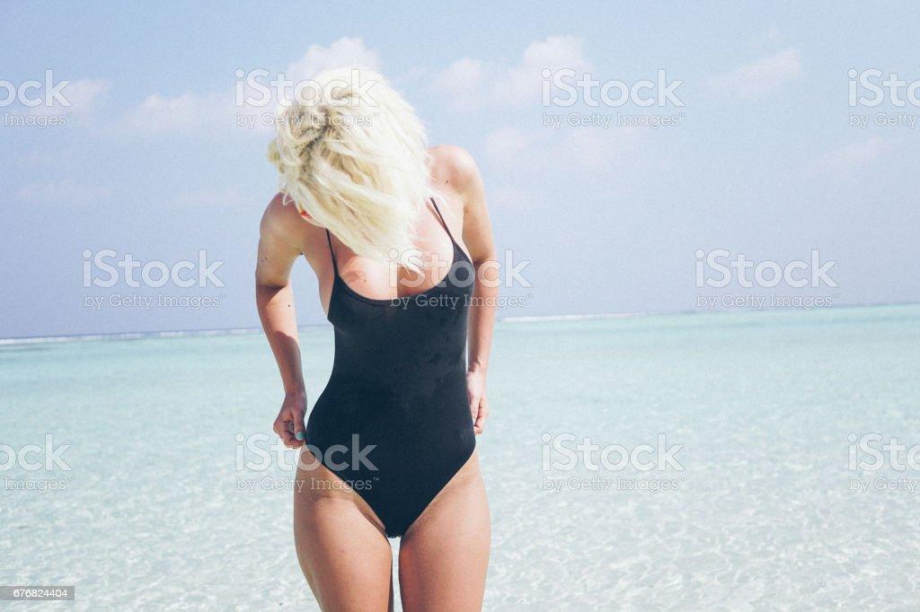 Sexy woman next to the ocean, Maldives stock photo