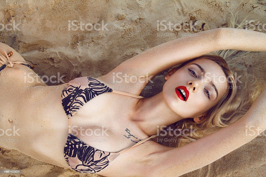 Sexy woman on the beach stock photo