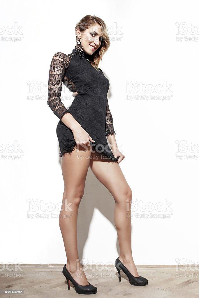 Sexy woman posing in black dress royalty-free stock photo