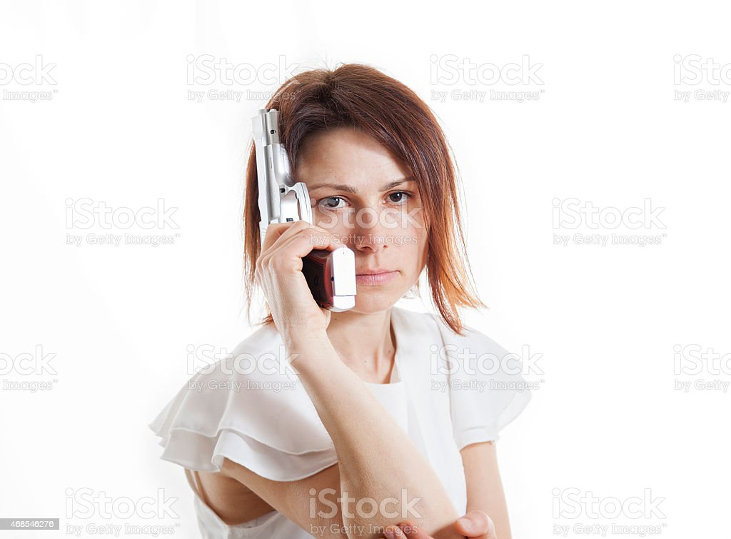 sexy woman posing with gun on white background stock photo