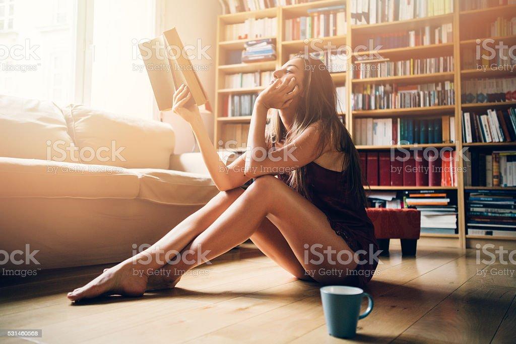 Sexy woman reading a book stock photo