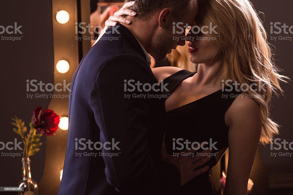 Sexy woman seducing a man stock photo