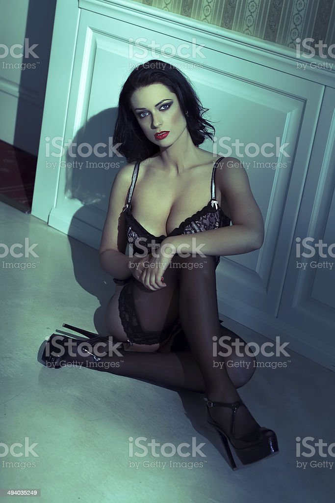 Sexy woman sitting on the floor royalty-free stock photo