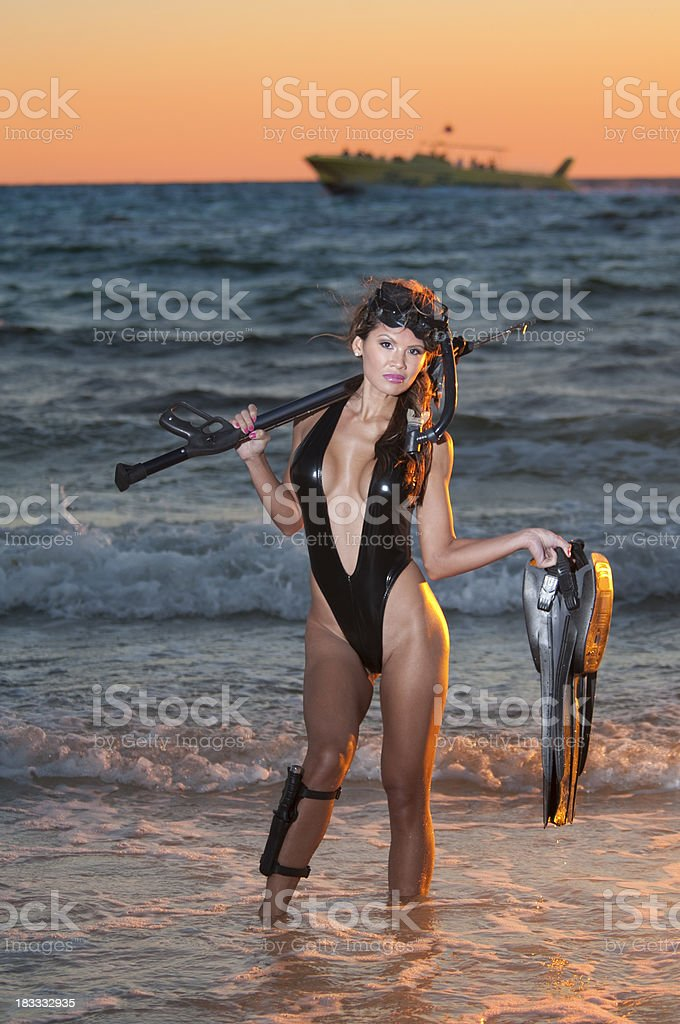 Sexy Woman Sport Diver in the Surf at Sunset stock photo
