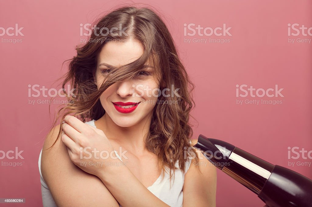 Sexy woman with a hair dryer stock photo