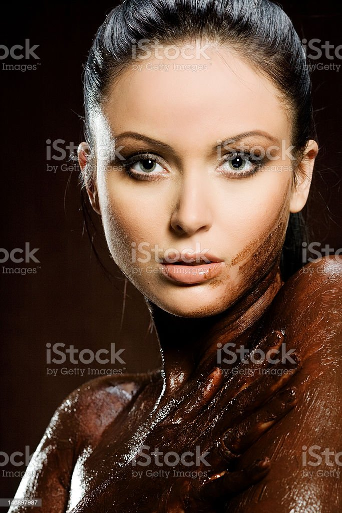 Sexy woman with body covered of sweet cream chocolate royalty-free stock photo