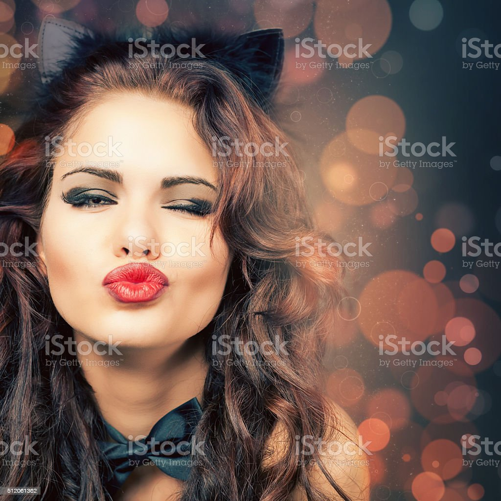 Sexy woman with carnival mask at Venetian party stock photo