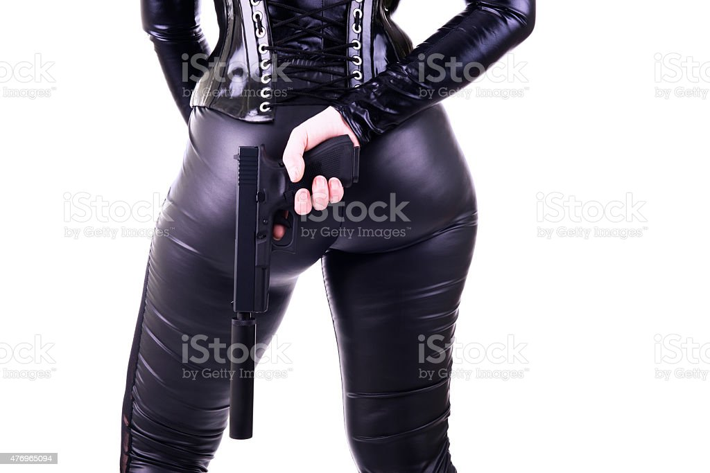 Sexy woman with gun. stock photo