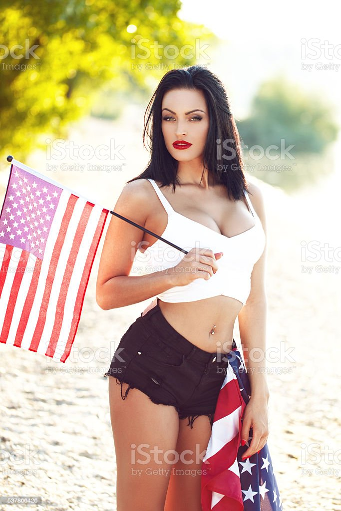 Sexy woman with  little USA flag outdoor stock photo