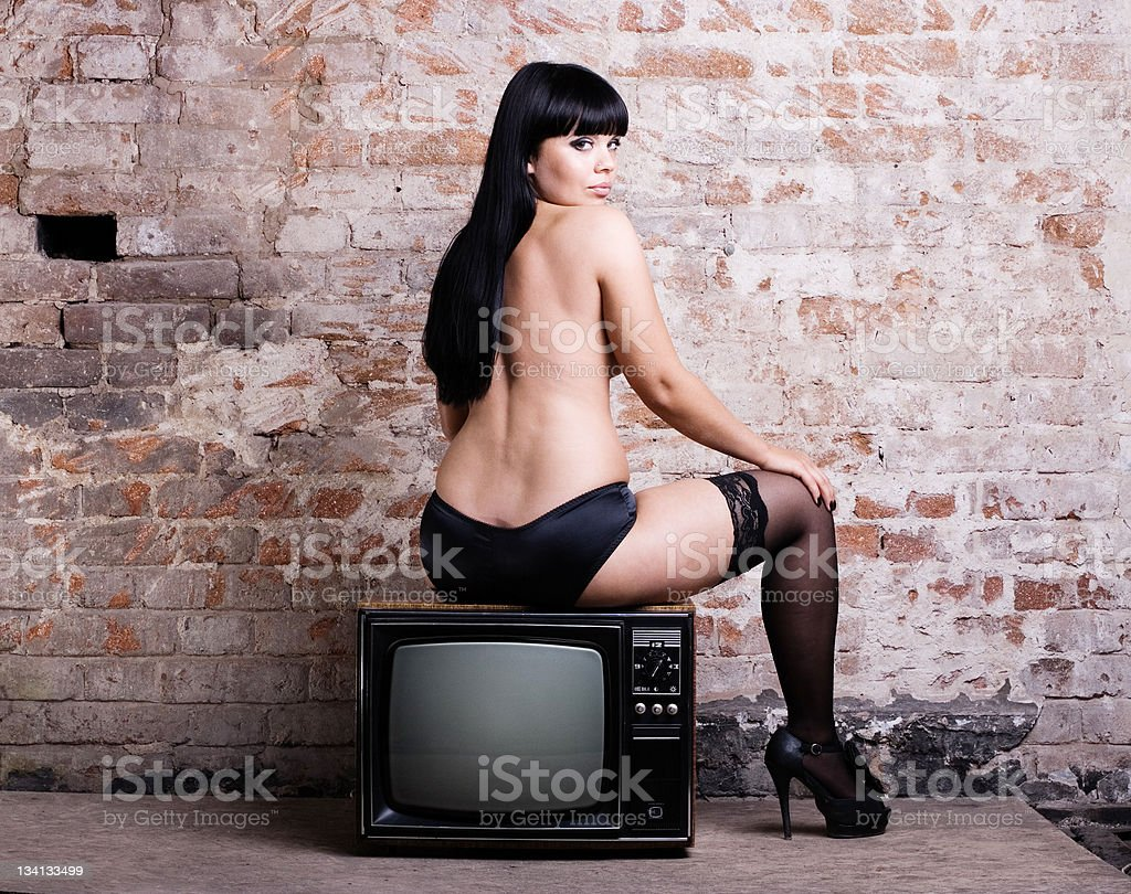 sexy woman with retro TV royalty-free stock photo