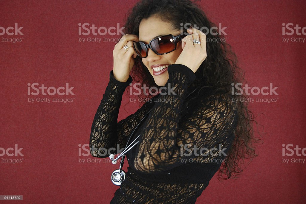 Sexy woman with stethoscope royalty-free stock photo