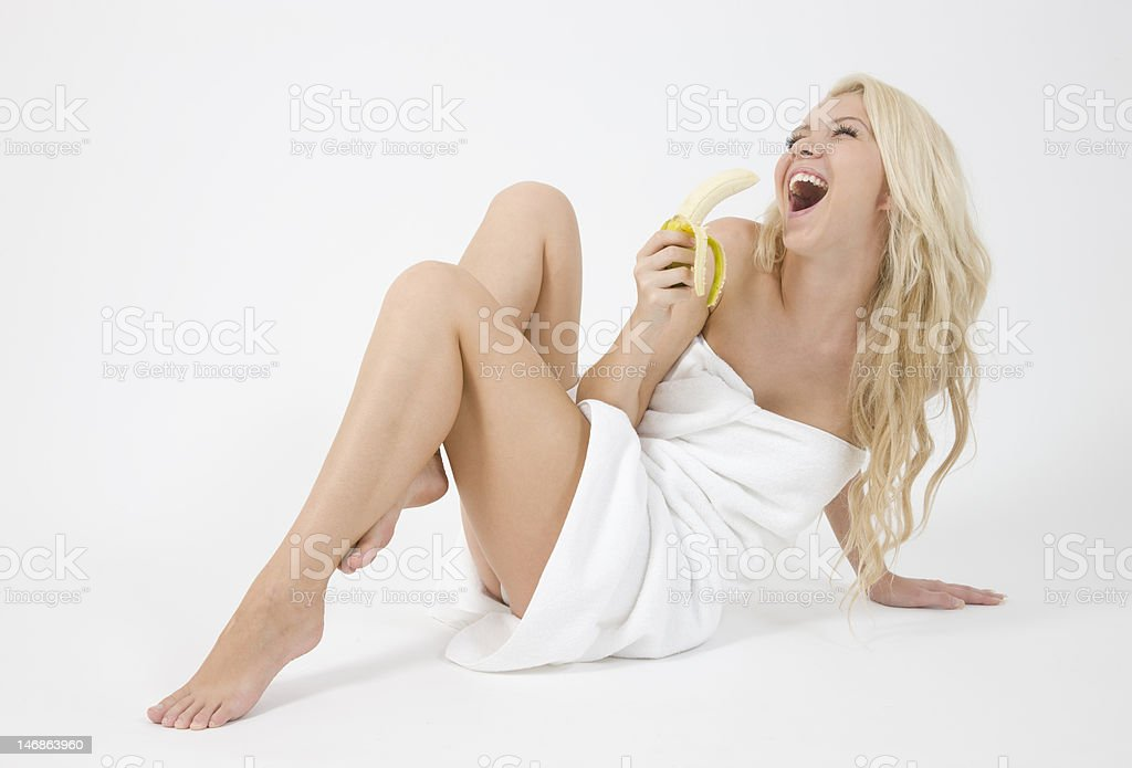 sexy woman with towel eating a banana royalty-free stock photo
