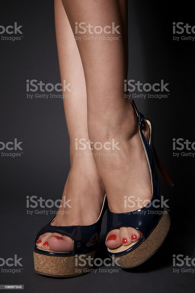 Sexy women legs in black shoes royalty-free stock photo