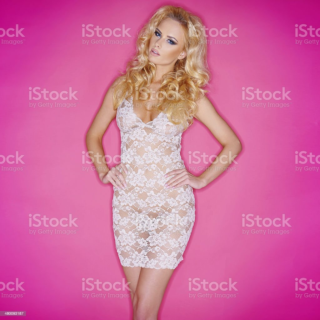 Sexy young blond in a see-through dress royalty-free stock photo
