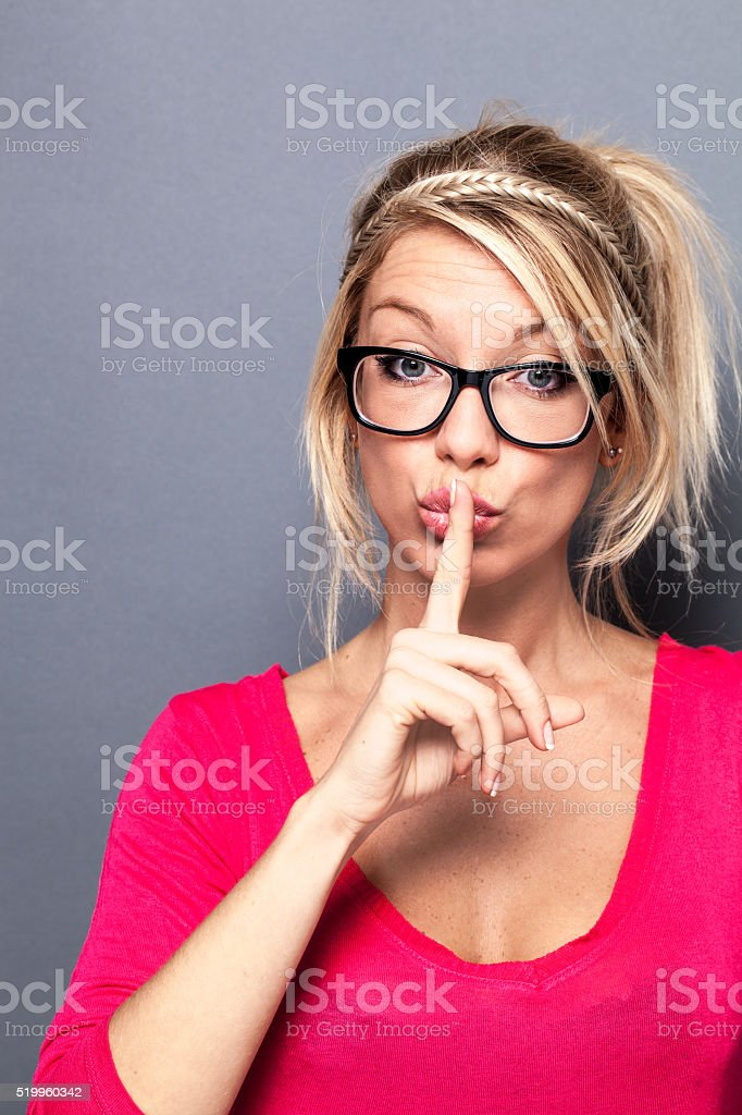 sexy young blond woman keeping short-sighted eyesight with fashion stock photo