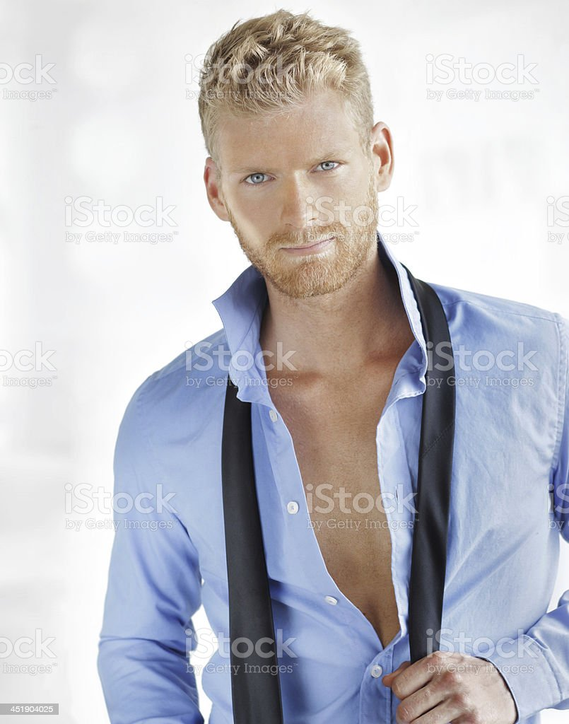 Sexy young business guy afterhours stock photo