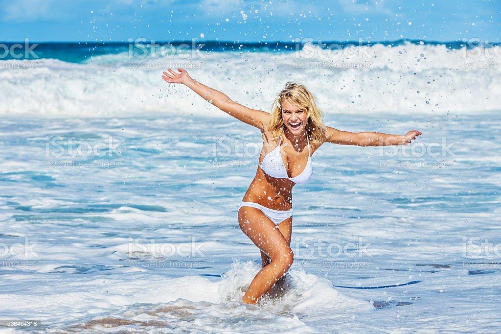 Sexy Young Carefree Woman on Hawaiian Beach wearing White Bikini stock photo