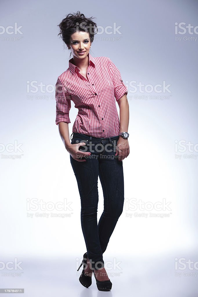 sexy young casual woman standing with her hands in pockets royalty-free stock photo