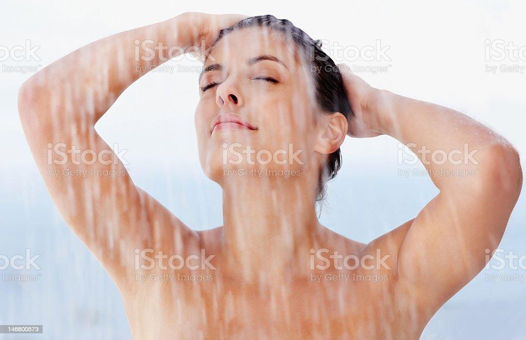 Sexy young female enjoying a bath royalty-free stock photo