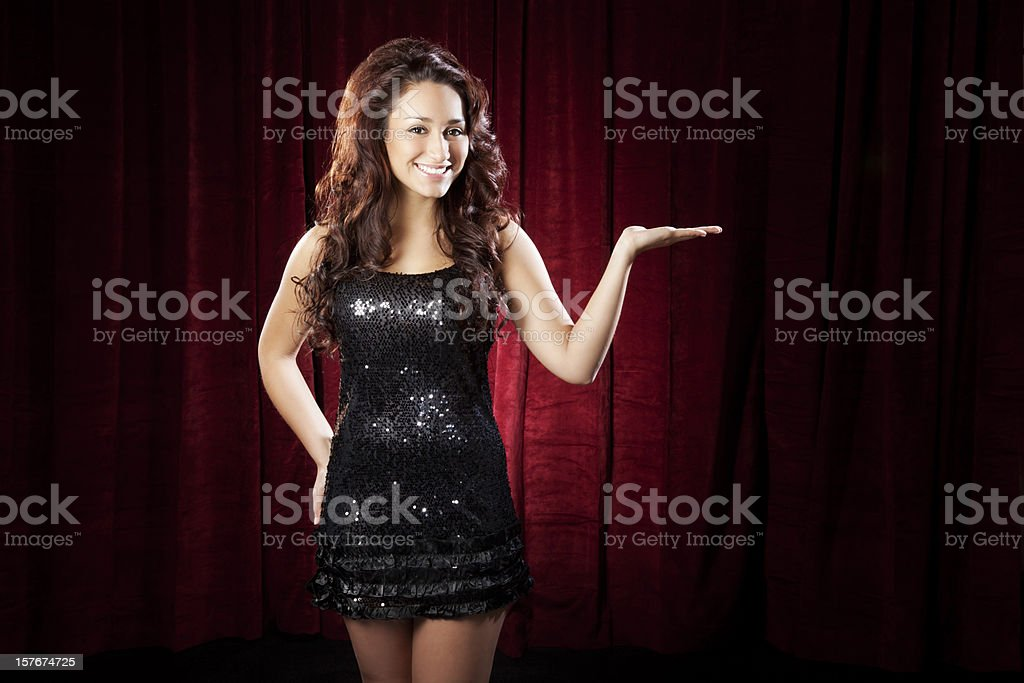 Sexy Young Hispanic Woman Presenting on Stage stock photo