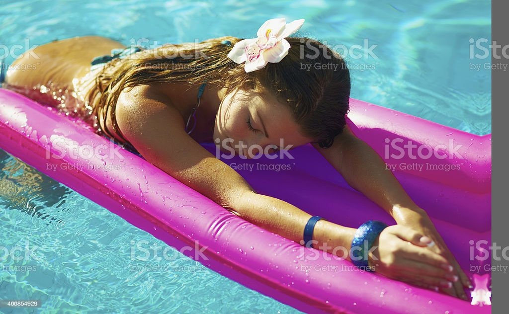 Sexy young lady swimming in the pool royalty-free stock photo