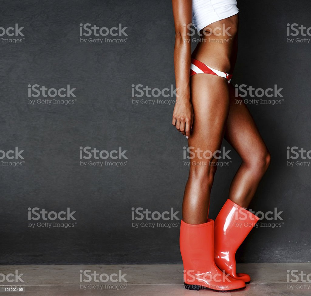 Sexy young lady's legs wearing gumboots stock photo