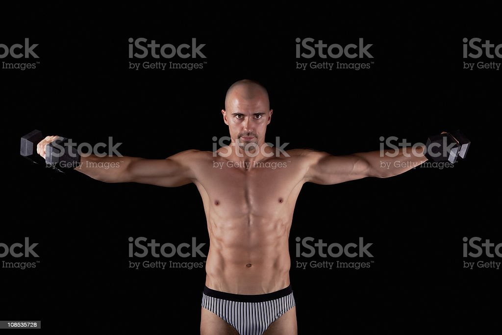 Sexy young male with dumbells royalty-free stock photo