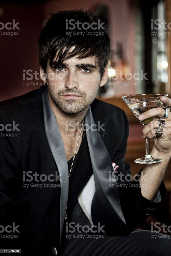 Sexy young man in tuxedo with martini royalty-free stock photo