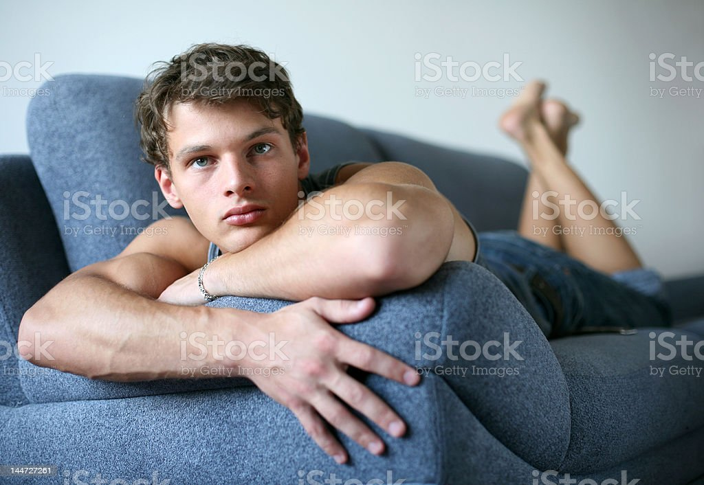 Sexy Young Man on the Sofa royalty-free stock photo