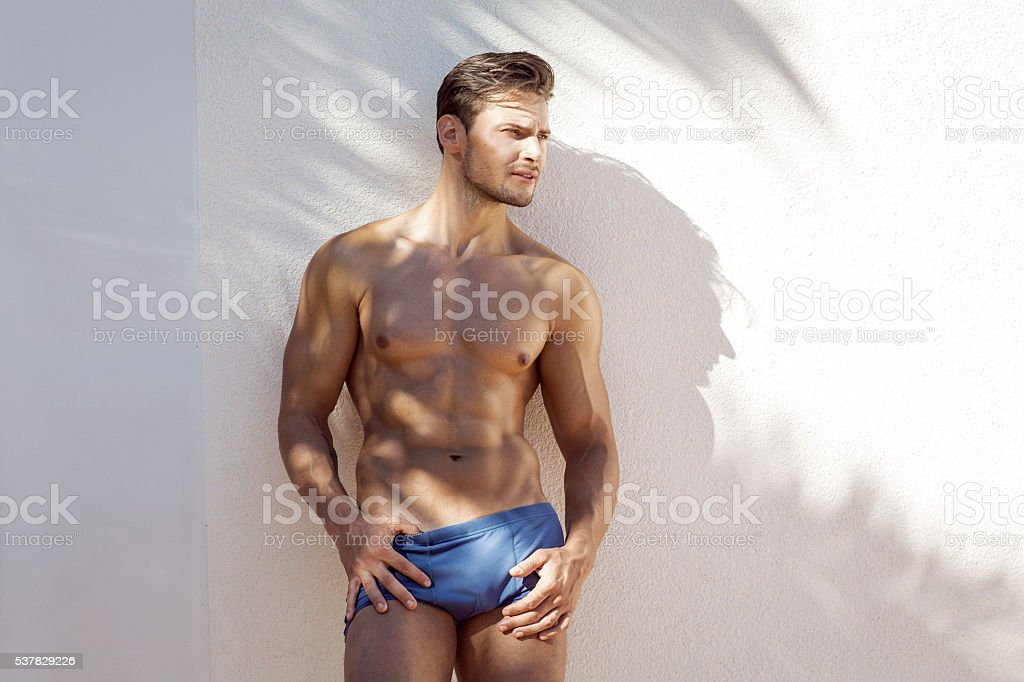 Sexy young man outdoor stock photo