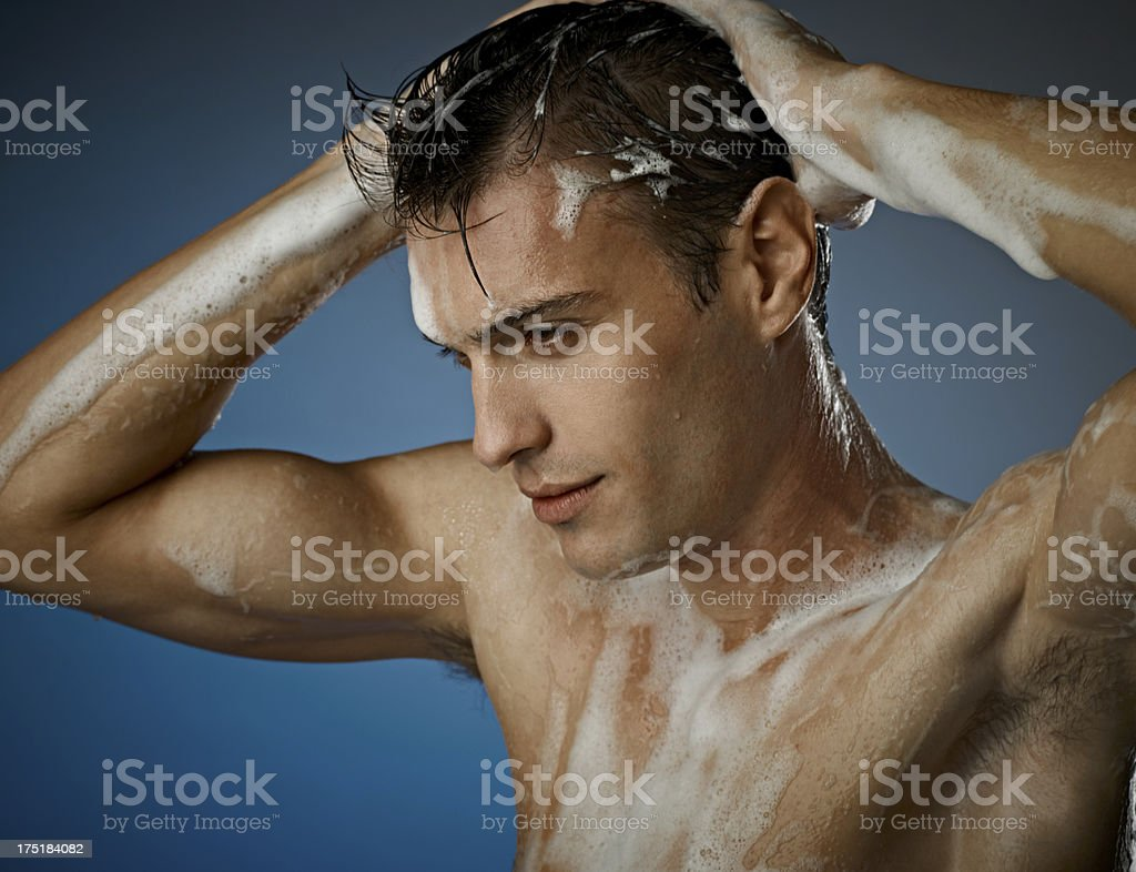 Sexy Young Man Taking a Shower royalty-free stock photo