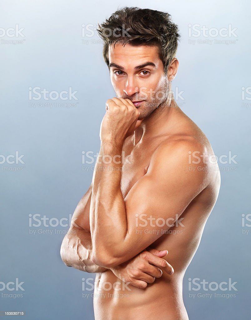 Sexy, young man with a flirtatious looks royalty-free stock photo