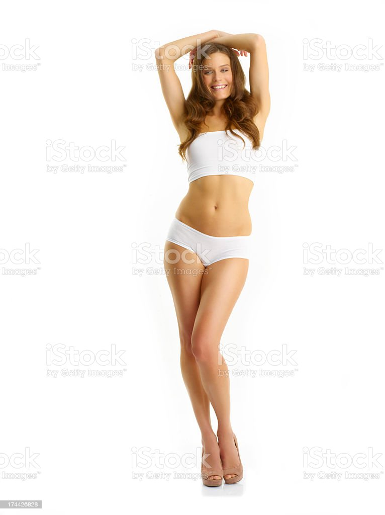 Sexy young slim woman posing with a perfect body stock photo