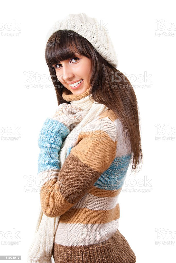 Sexy young woman dressed in a sweater, scarf and cap royalty-free stock photo