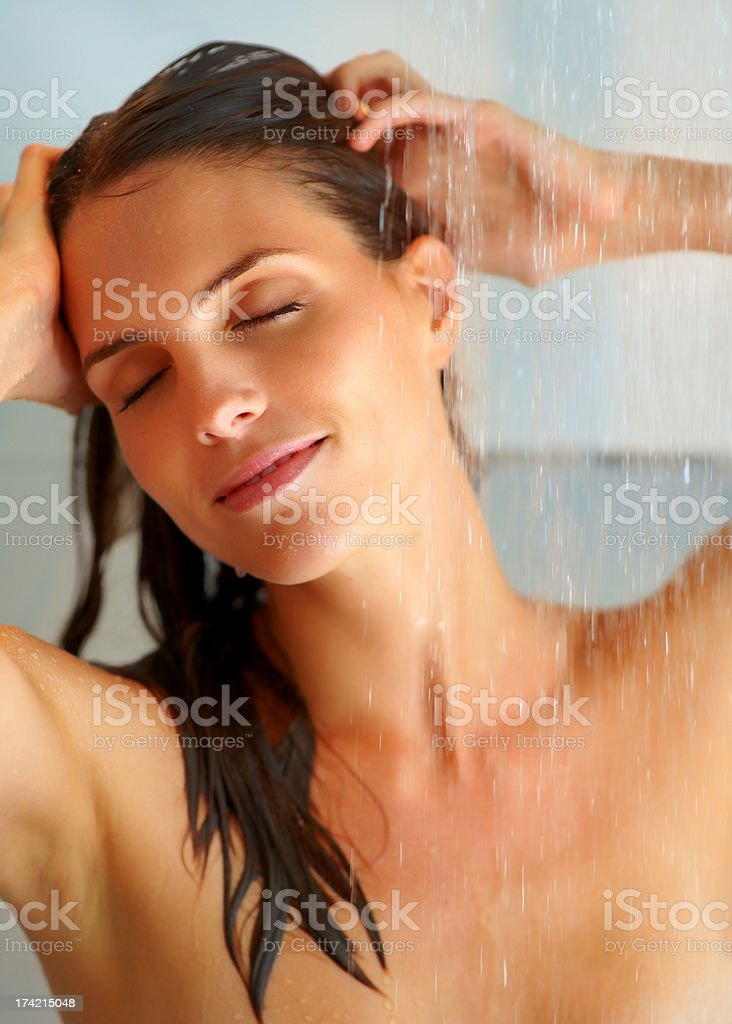 Sexy young woman enjoing bath under water shower stock photo