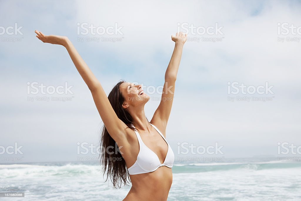 Sexy young woman enjoying on the beach royalty-free stock photo