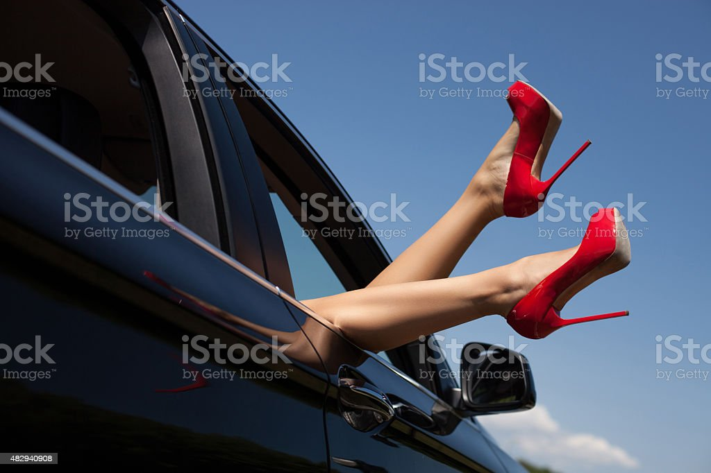 Sexy young woman feels freedom in her car stock photo