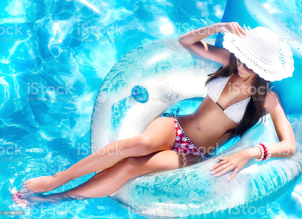 Sexy young Woman floating stock photo