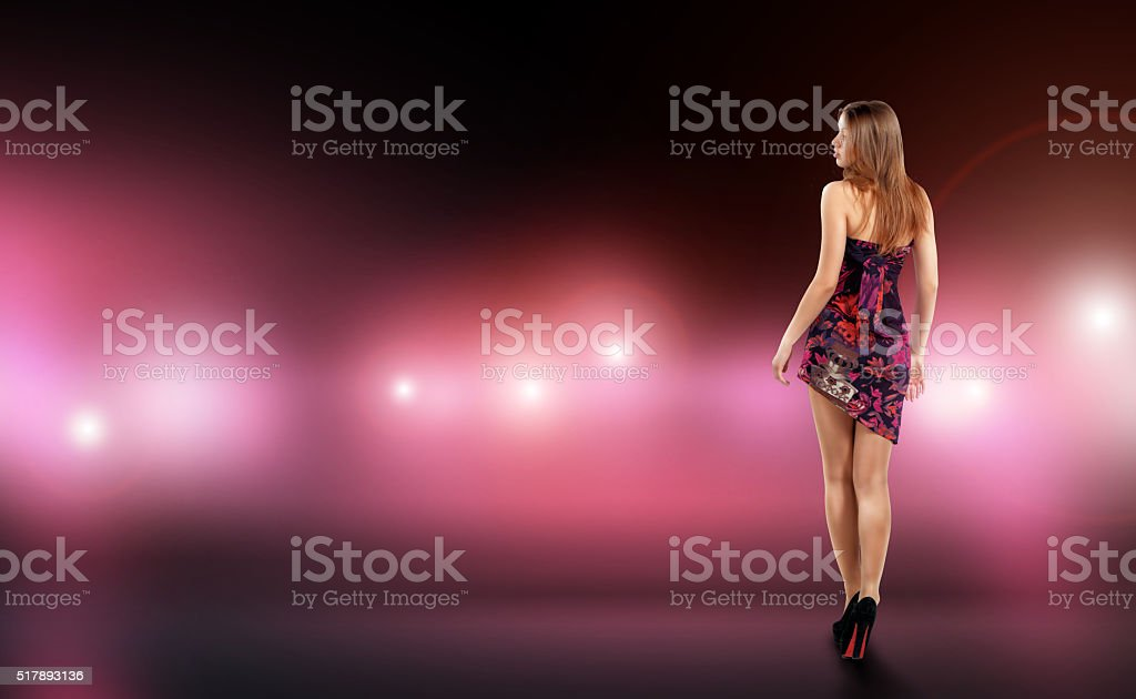 Sexy young woman in fitting dress surrounded by care and stock photo