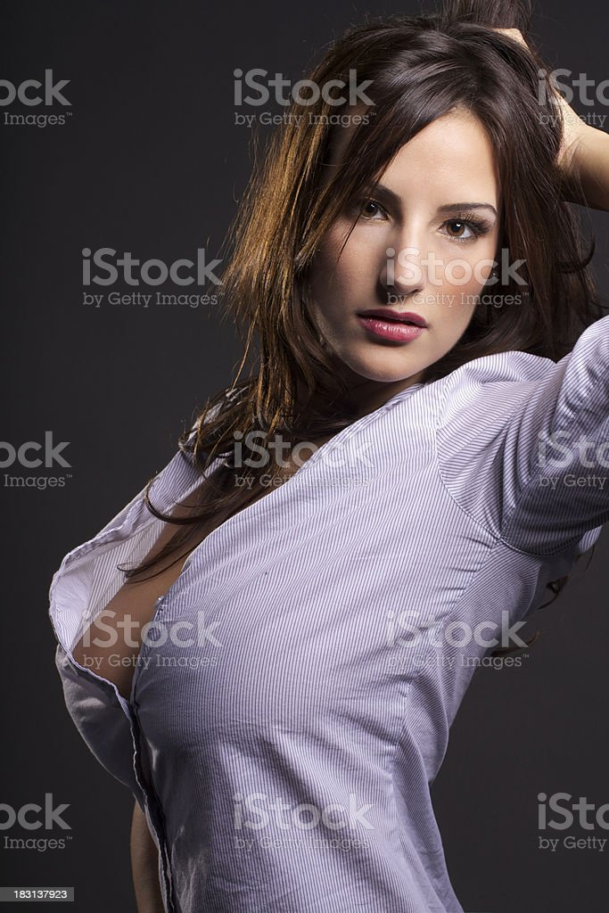 Sexy young woman in her boyfriend's shirt stock photo