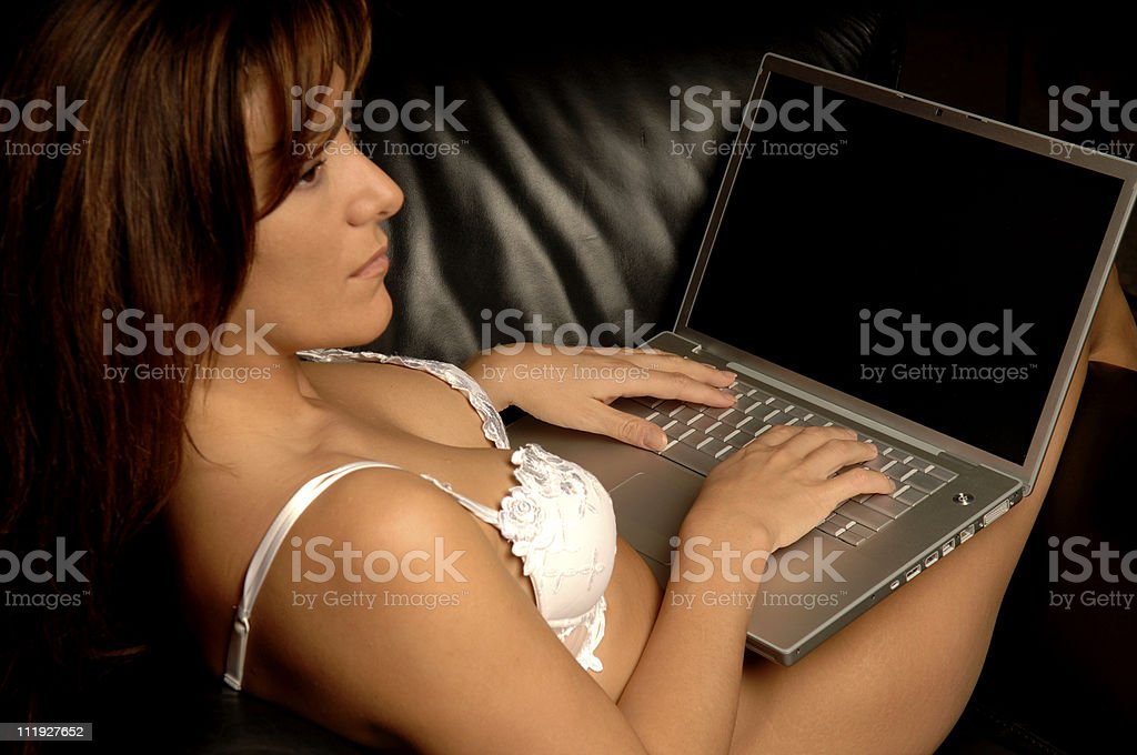 Sexy Young Woman in Lingerie Typing on Laptop Computer royalty-free stock photo