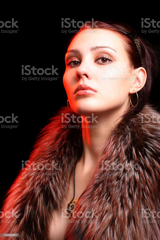 Sexy young woman over black background with moody light royalty-free stock photo