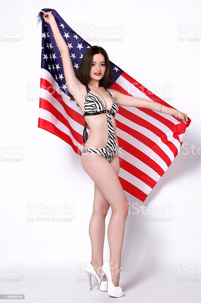 Sexy young woman posing over american flag background royalty-free stock photo