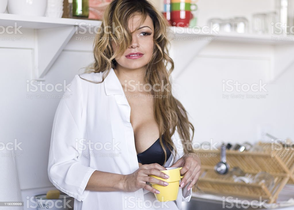 Sexy young woman standing in kitchen royalty-free stock photo