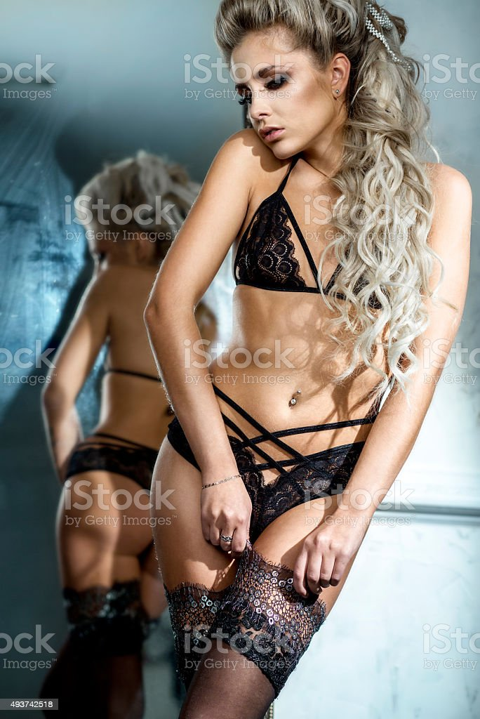 Sexy young woman with a lingerie stock photo