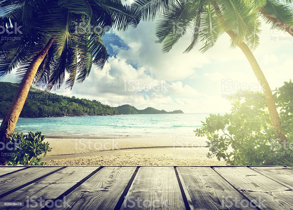seychelles beach and wooden pier stock photo