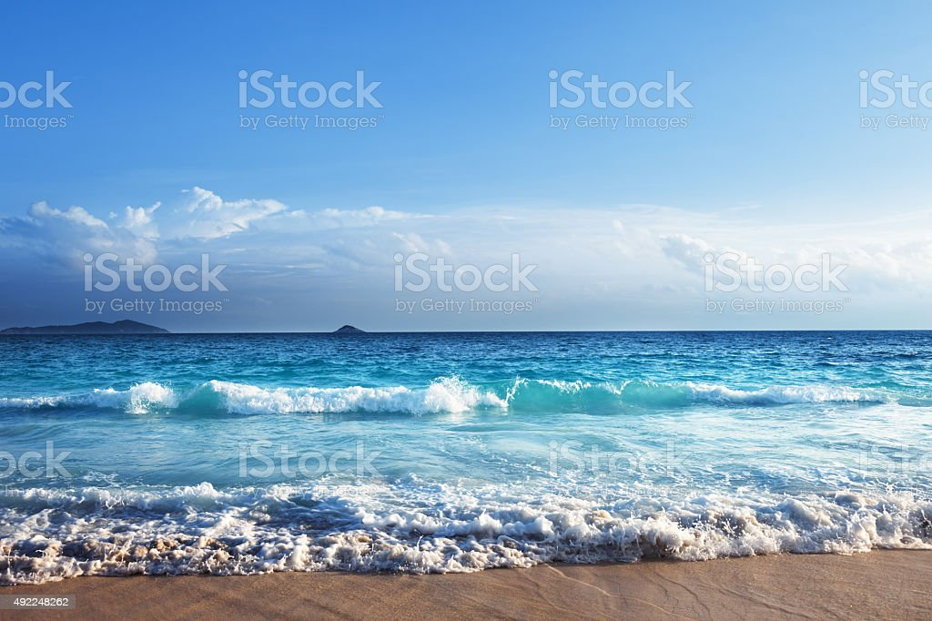 seychelles beach in sunset time stock photo
