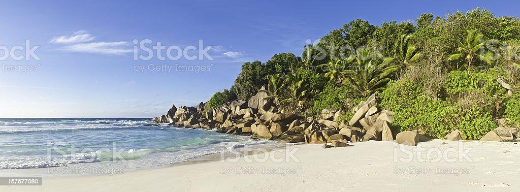 Seychelles Grande Anse tropical island beach palm trees turquoise ocean royalty-free stock photo