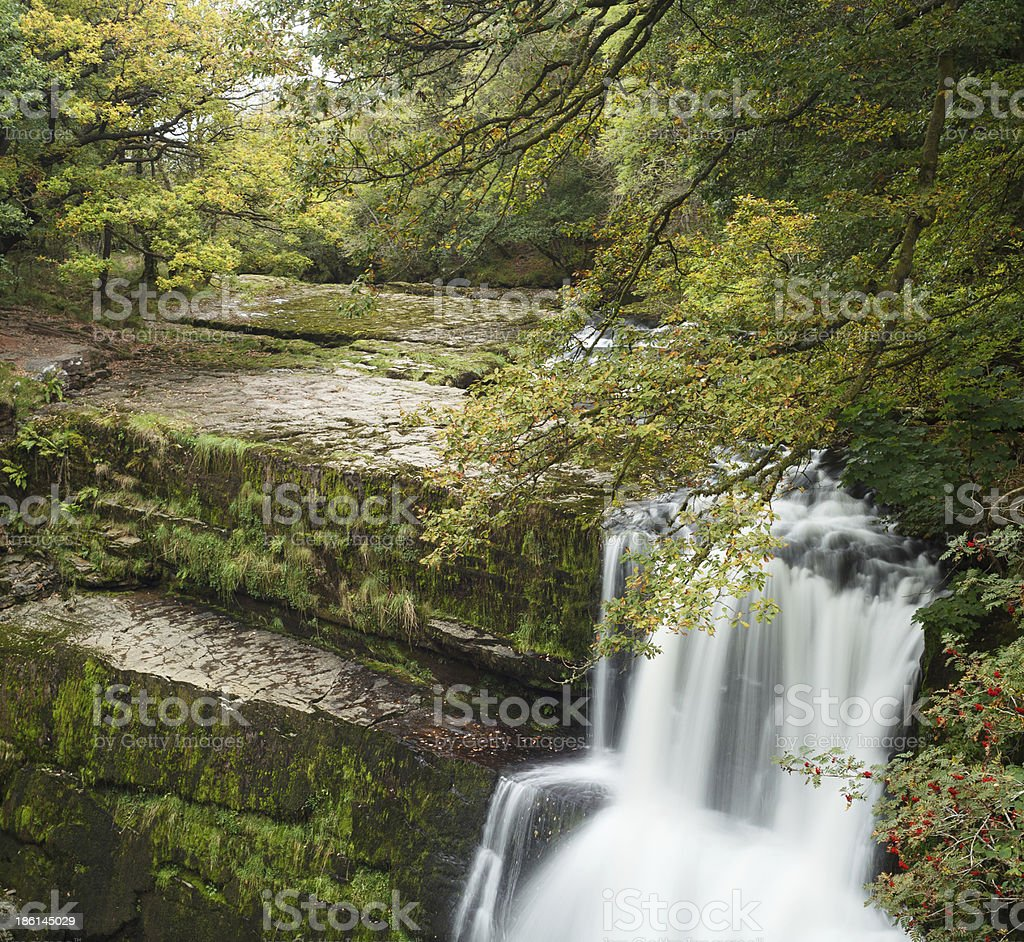 Sgwd Clun-Gwyn Waterfall in Autumn stock photo