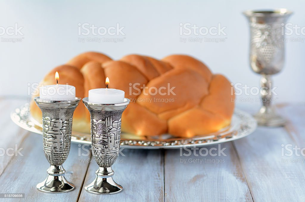 Shabbat candles with Challah and wine stock photo